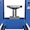 Forklift tire press with a roll-in table for loading and unloading parts